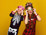 mother and daughter in halloween costume having fun time - 177893577