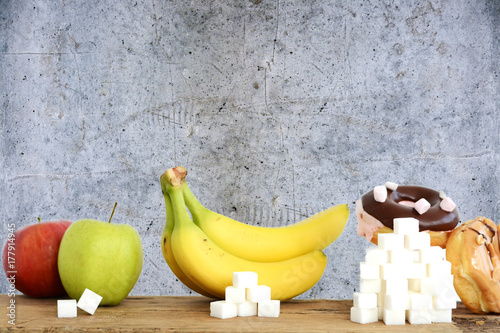Foto Murales Choose healthy fruits instead of unhealthy sweets with huge quantity of sugar