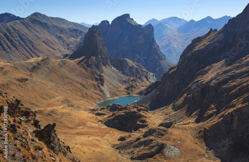 A valley in the French Alps during a clear day in autumn.