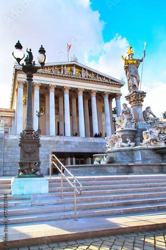Statue and fountain of Pallas Athena, Parliament buildingin Vienna, Austria Poster