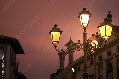 Montagnana, Italy. street lamp shines on the city street.