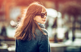 Close up fashion portrait of trendy woman in coat at the city - 177937161