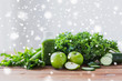 close up of bottle with green juice and vegetables - 177953947
