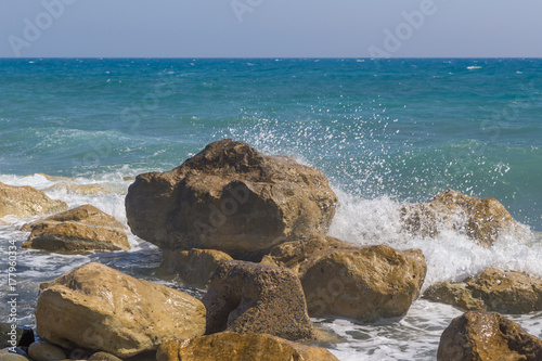 Fotobehang Cyprus Rocks and waves with splash