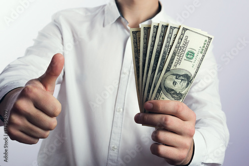 One hundred dollar bills in the hands Poster