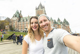 Couple in front of Chateau Frontenac at Quebec city Canada - 177974561