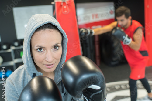 female boxer looking at the camera Poster