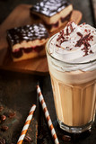 Glass of frappe coffee on table