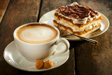 Cup of milk coffee with piece of cake - 178009540
