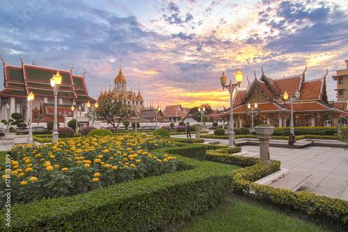 Sunset at Wat Ratchanatdaram Temple in Bangkok, Thailand. Poster