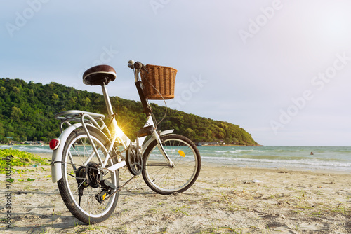Fotobehang Fiets Bicycle on the beach at sunset background,relaxing concept.