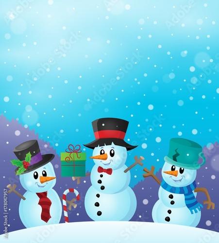 Papiers peints Enfants Christmas snowmen in snowy weather