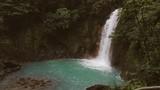 Celeste river waterfall and pond, Tenorio Volcano, Costa Rica