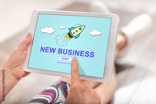 Sticker New business concept on a tablet