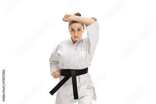 Girl in a kimono doing a karate kata Poster