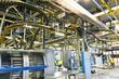 Interieur einer Industrieanlage - Großdruckerei: Maschinen und Transportbänder  // Machinery and conveyor belts in an industrial plant - Large printing works