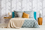 Bed against forest motif wallpaper - 178080585