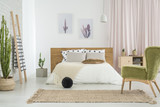 Fototapety Green retro chair in bedroom