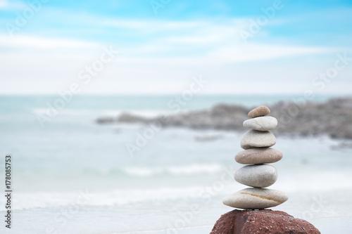 Foto op Aluminium Stenen in het Zand Stack of pebble stones at the beach, Summer, Beach