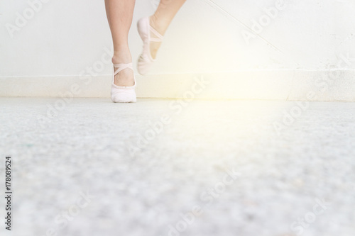 ballet right foot stand position on the street with point shoes, light effect Poster