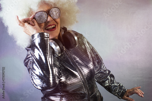 grandma DJ partying in a disco setting Poster