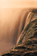 Up Close Vantage Point on the Side of A Power Waterfall at Sunrise