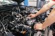 mechanic working on engine repairs
