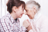 Seniors woman with her caregiver at home - 178112551