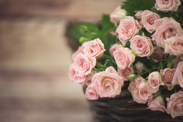 beautiful roses are in the basket