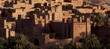 Morocco's fortified town or ksar of Ait Benhaddou; its earthen-clay architecture catching the golden light of sunrise.The UNESCO world heritage site has featured in numerous films and TV series. - 178132163