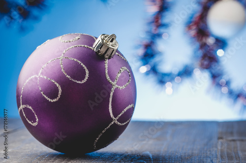 violet Christmas ball on a blue light background/violet Christmas ball on a blue light background Poster