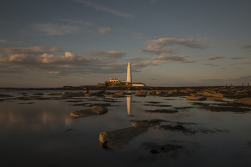 St Mary's Lighthouse at dusk, reflecting in bay