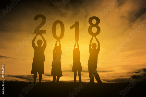 Family happy new year 2018 silhouette.