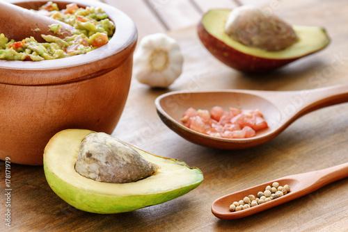 Closeup view of ripe avocado and fresh homemade Guacamole