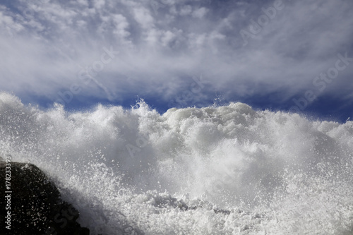 Breaking waves invading the rocky coast