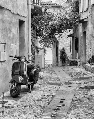 Aluminium Scooter Old narrow street in the in France.