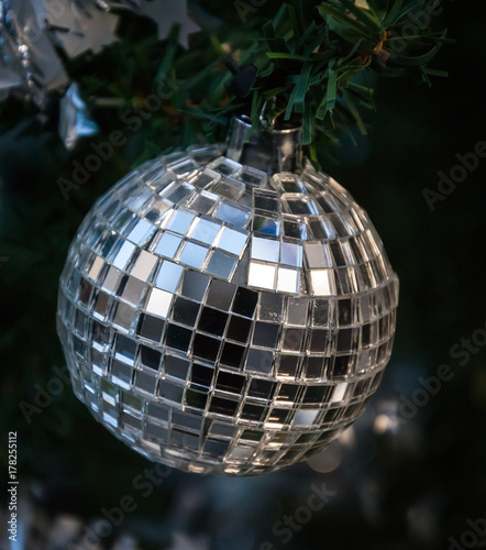 Christmas tree decorated with grungy mirror disco ball. - 178255112