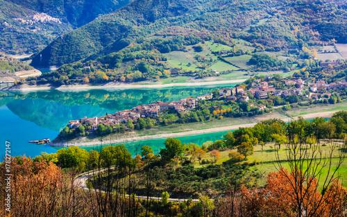 Fotobehang Freesurf beautiful lake Turano and village Colle di tora. Rieti province, Italy