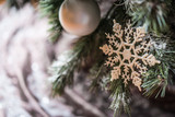 Snowflake ornament and bubles on Christmas tree, closeup and copy space