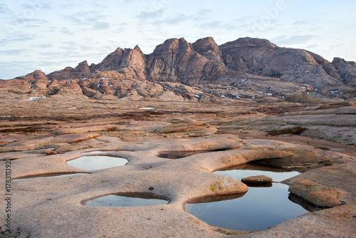 Fotobehang Donkergrijs Views of Mount Bektau Ata. Bektau Ata - a mountainous area in the middle of the Kazakhstan steppe, within a radius of about 5-7 km.