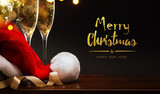 merry Christmas and happy New year; champagne and Santa hat - 178319962