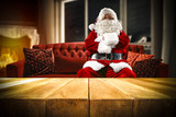 santa claus on sofa and wooden table place