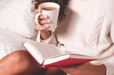 Hands holding book and mug - 178350516
