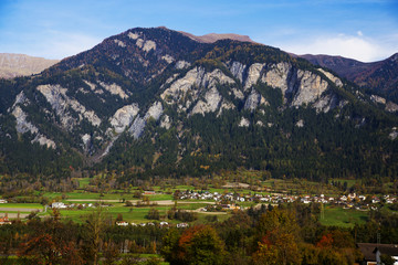Italian Alps in autumn, stunning views of the background of the small town