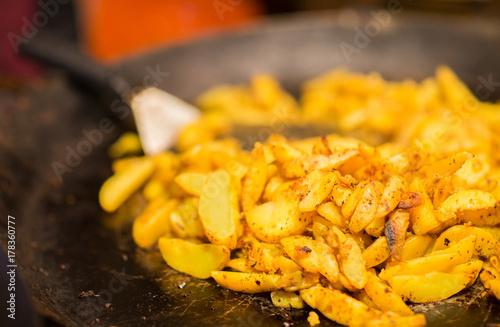 Fridge magnet fried potato on stir fry pan