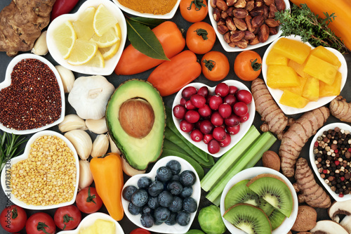 Foto Murales Health food for fitness concept with fruit, vegetables, pulses, herbs, spices, nuts, grains and pulses. High in anthocyanins, antioxidants, smart carbohydrates, omega 3,  minerals and vitamins.