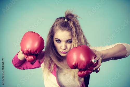 Cute girl in red gloves playing sports boxing Poster