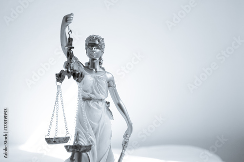 Naklejka Woman statue symbol of justice Themis