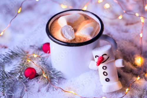 Foto op Canvas Chocolade Hot chocolate with cute marshmallow snowman on winter background with christmas decoration