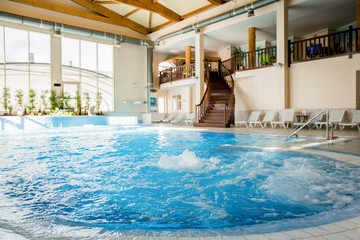 Interior of contemporary dayspa resort with whirlpool full of warm splashing water in the center © pressmaster